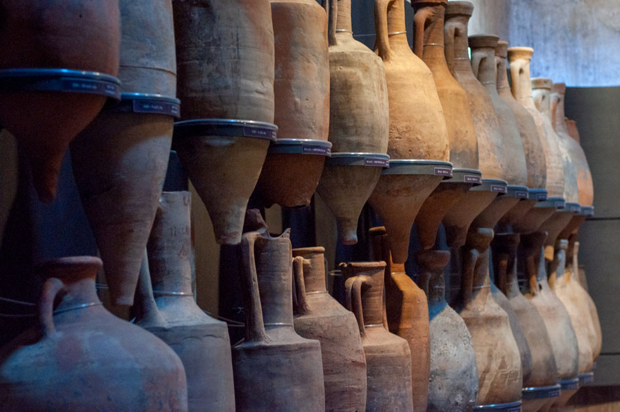 amphorae lined up on the wall