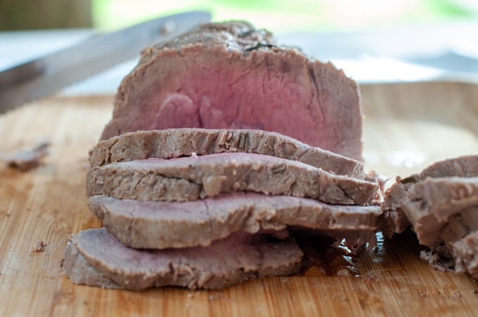 Sliced roast beef with perfect pink meat inside cooked medium rare
