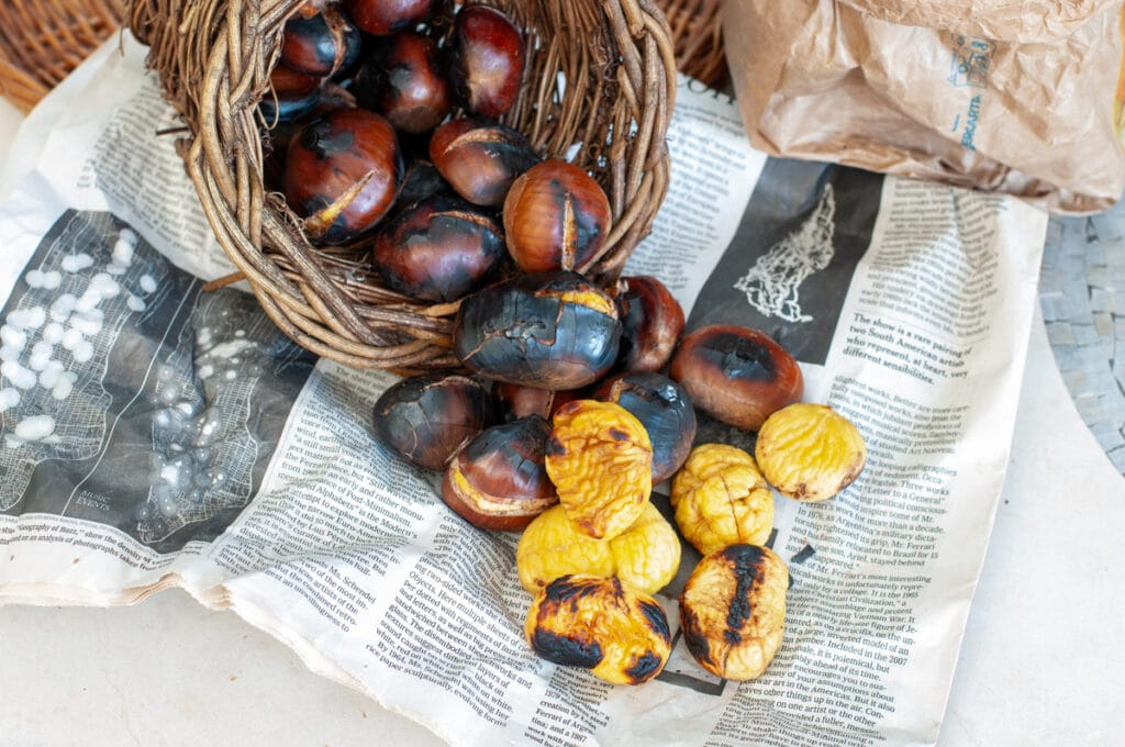 roasted chestnuts on a newspaper