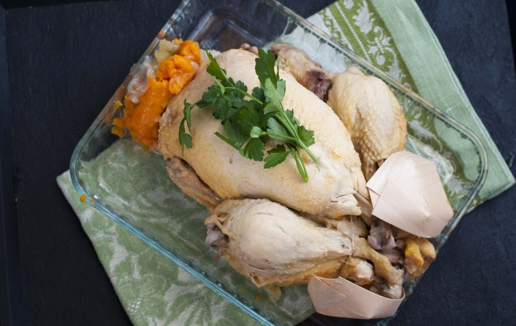 boiled chicken on a serving dish