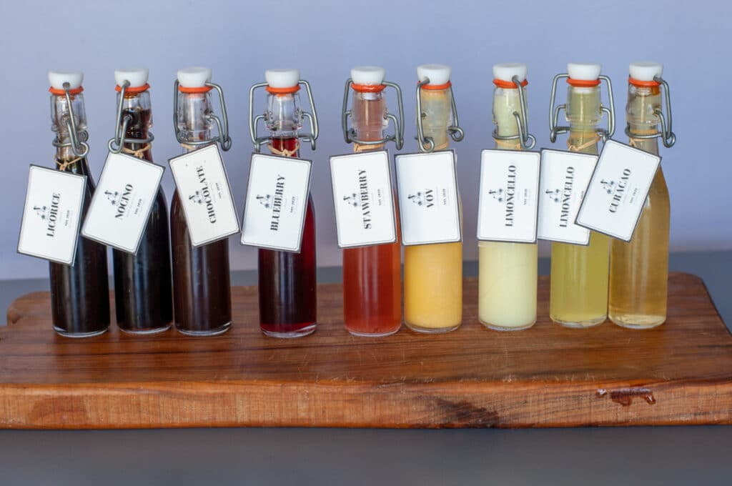 different liqueurs bottles lined up with labels