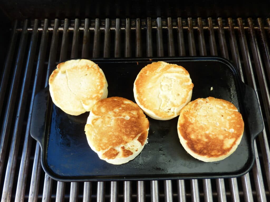 English muffins cooked on an outdoor barbecue grill