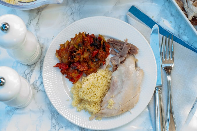 boiled chicken served with baked ratatouille and couscous