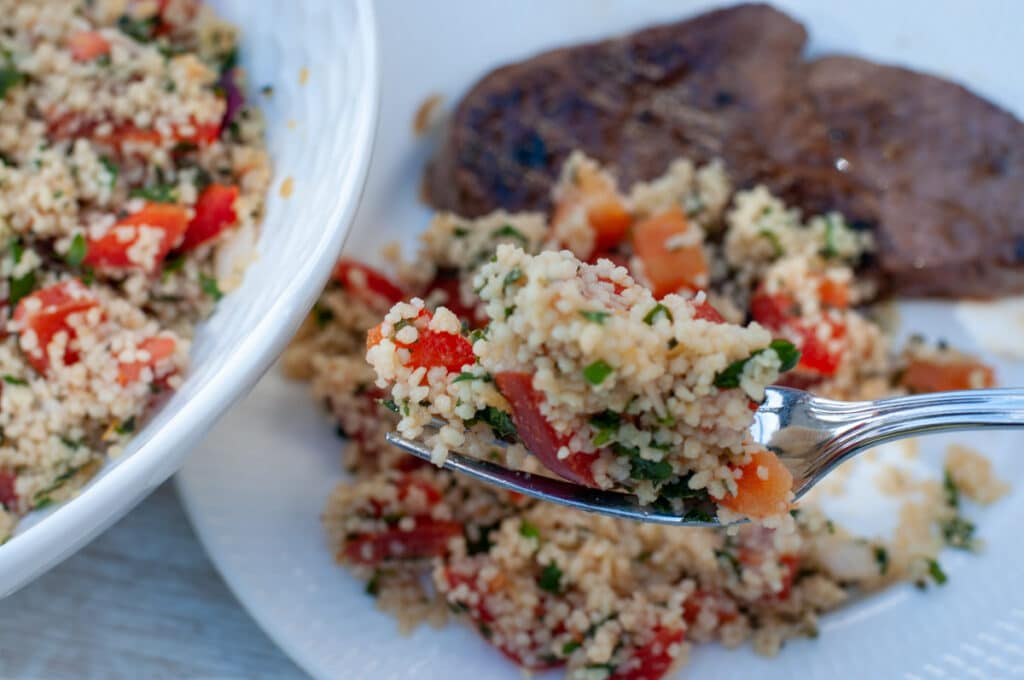 tabbouleh on a fork served with a stake