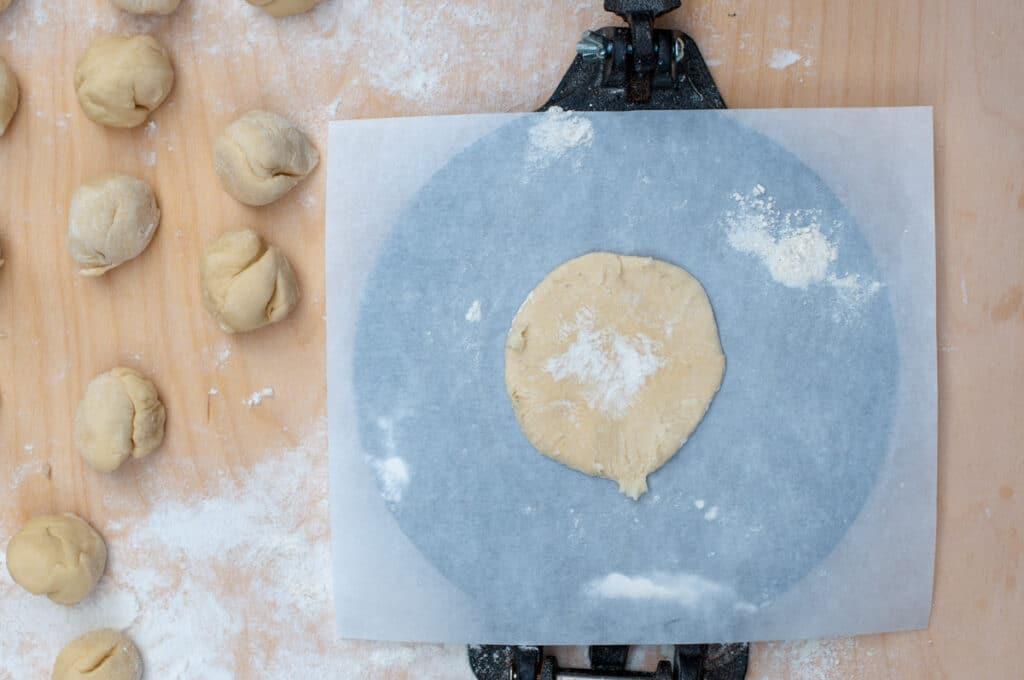 dough pressed into a dough press