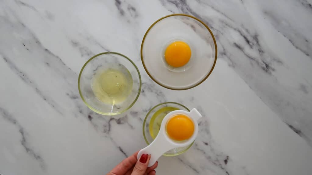 Separating the egg whites in a different bowl